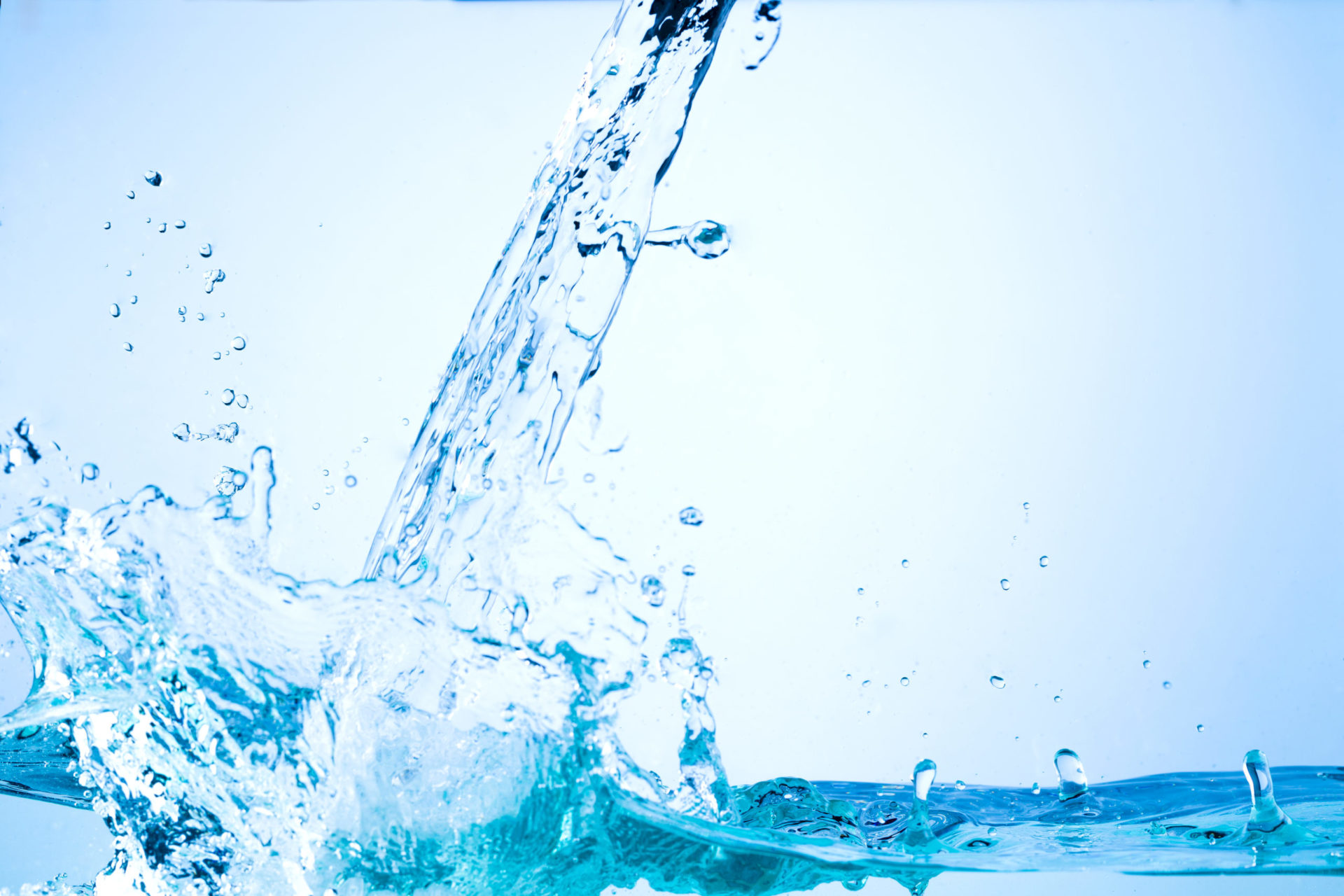 neutral background image of flowing water with splashes and drops of water