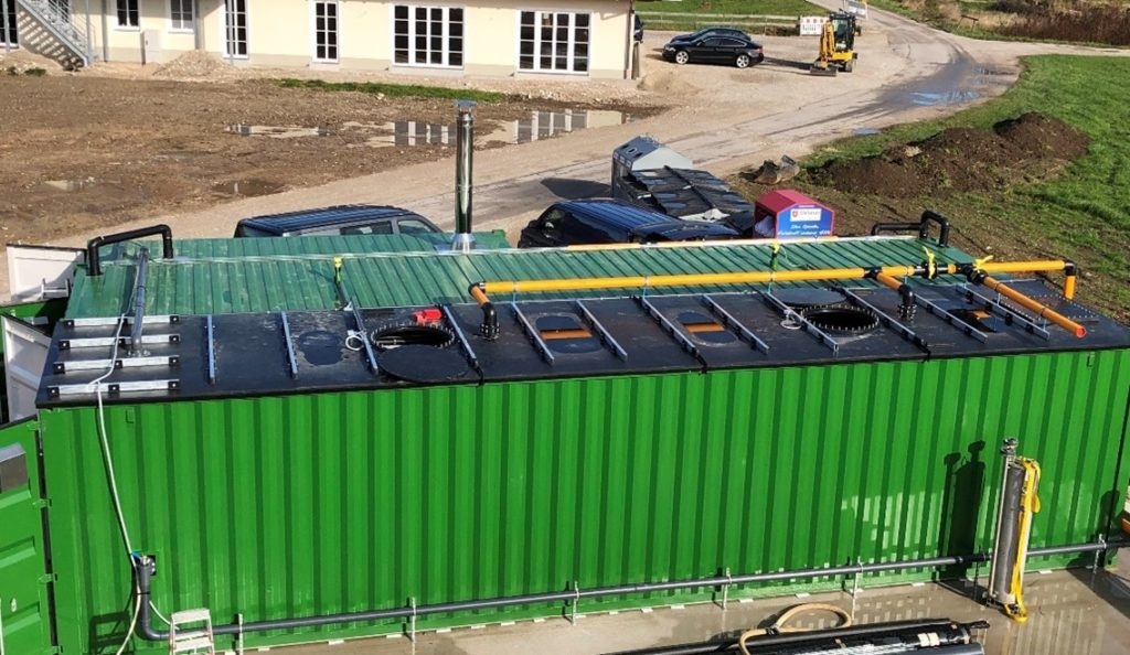 a green container system from FlexBio Technologie GmbH from the outside on a farm